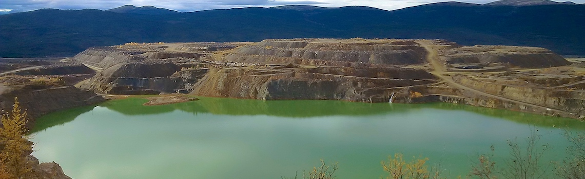 Open pit and waste-rock piles at the Faro Mine, Yukon